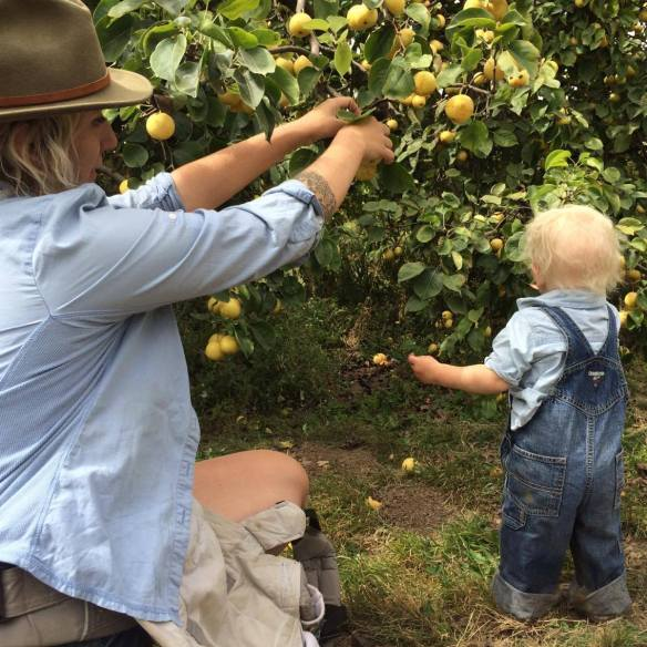 Destiny Hagest and her son picking fruit