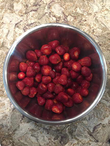 hulled strawberries in bowl
