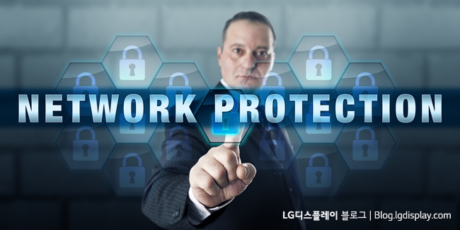 Security manager is touching NETWORK PROTECTION on an interactive visual display. Business metaphor and information technology concept for securing enterprise computing infrastructure.