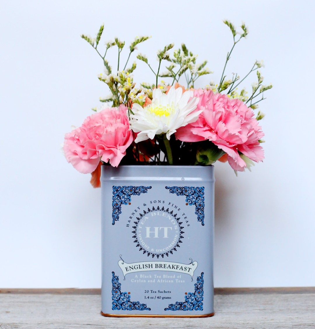 Upcycling tea tins is essential to making your space extra-cozy this winter!