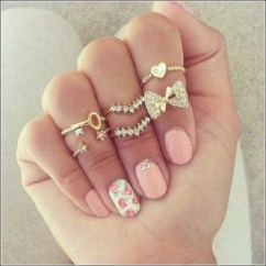 Female hand wearing stackable rings.