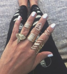 Personalized stacking rings on a hand.