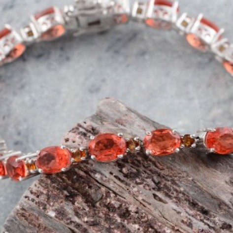 Bracelet with orange gemstones.