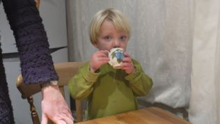 sampling a small beaker of water