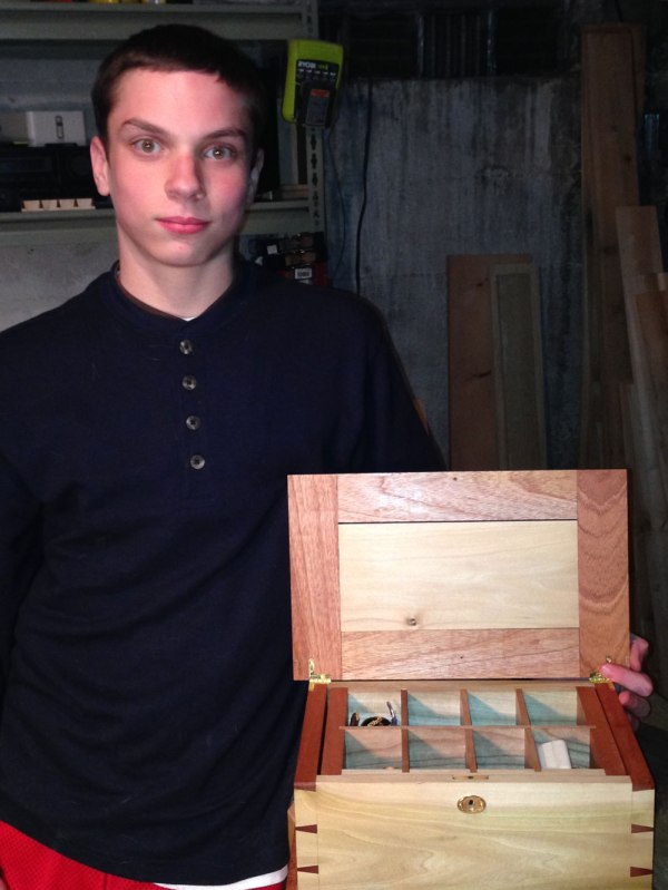Danny with a jewelry box he made for my mother. It is made out of poplar, African mahogany and cherry. It is dovetailed at the corners and has a tray that lifts out to allow for more storage. The tray is dovetailed at the corners with houndstooth dovetails.
