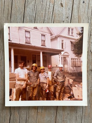 Anissa's father, George (far left), with friends after the flood of 1972 in front of the Kapsales family home. The Susquehanna River flooded the whole city, and everybody helped each other rebuild their homes.