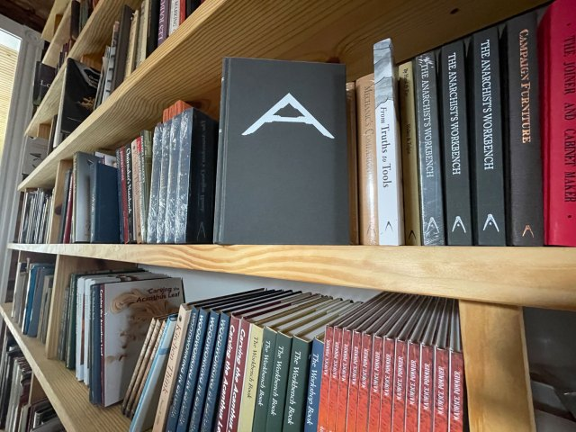 Lost Art Press books displayed on handmade wooden bookshelves in our office.
