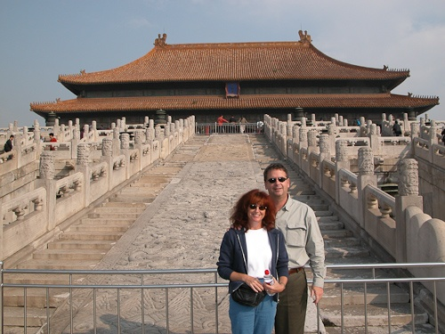 Alana & Barry touring the Forbidden City in Beijing, China - © LoveToEatAndTravel.com