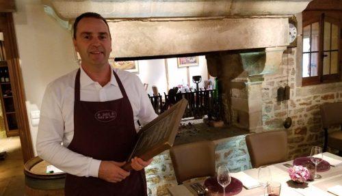 Le Bistro Bord de l'Eau sommelier with restaurant menu - Photo Credit: Deborah Grossman