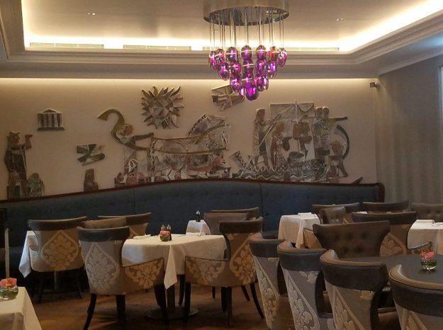 Lausanne La Brasserie du Roy dining room with Greek motif evoking the Olympic influence in Lausanne - Credit: Deborah Grossman