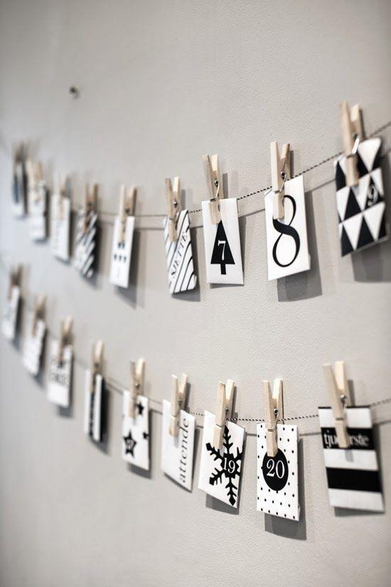 Une jolie ribambelle de pochettes en papier pour un calendrier de l'avent mural à créer soi-même, simple et graphique