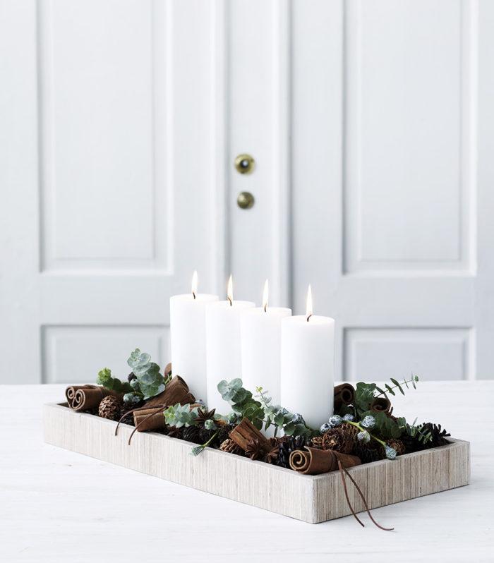 A la recherche d'une idée déco pour une table de noel ? Créez un centre de table avec des bougies