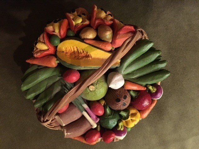 Souvenirs from Jamaica: Handmade Jamaican pottery depicting a basket of local produce