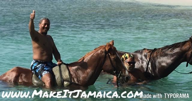Horseback riding in the ocean near Mais Oui villa in Discovery Bay, Jamaica