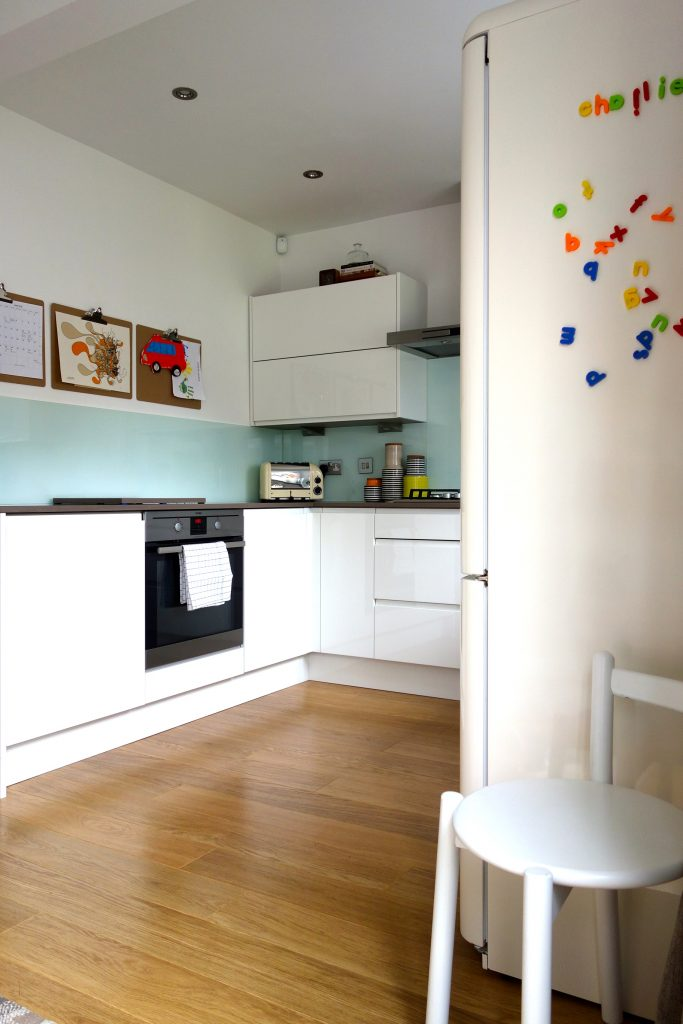 Kitchen After family wall with planner and children's art