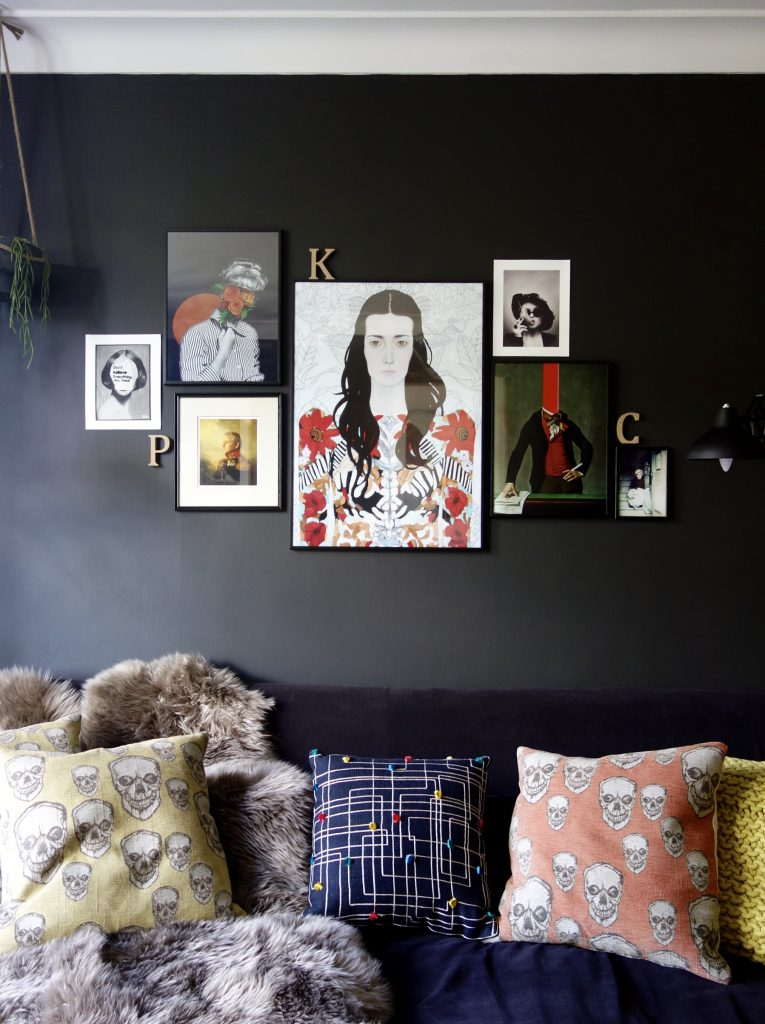Mixed media artwork on black walls