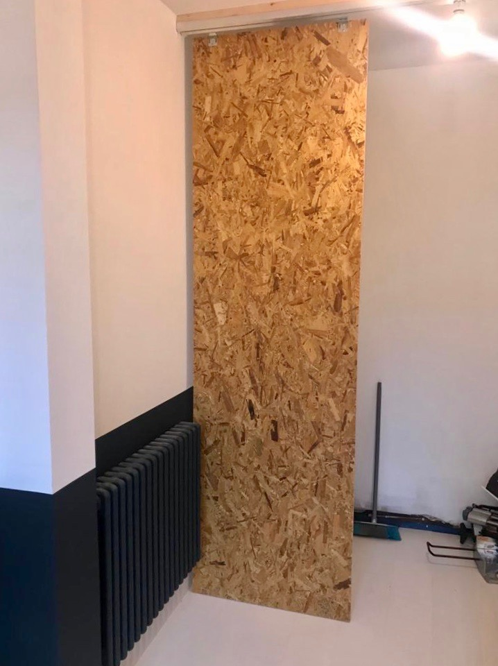 Integral Garage Conversion - During - OSB Sliding Wall