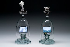 Tim Tate, Virtual Novelist, 2008. Blown and cast glass, electronic components, original video. Courtesy of the artist. Photo: Anything Photographic