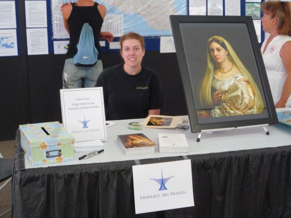 Stephanie McBride spreads the word about Raphael's Woman with the Veil at Festa Italiana in 2009.