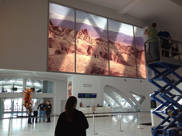 The large-scale reproduction of an Ansel Adams piece being installed in Windover Hall