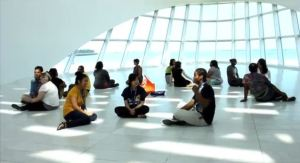 Students doing an activity in Windhover Hall. Screenshot of the teens' final project video.