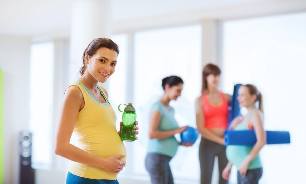 Pregnant women working out in a gym.