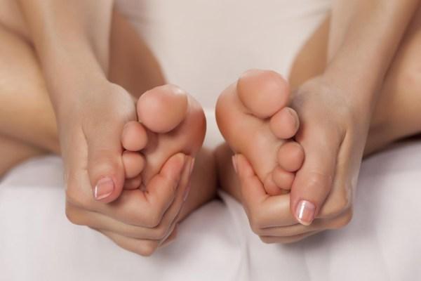 Woman massaging her feet.