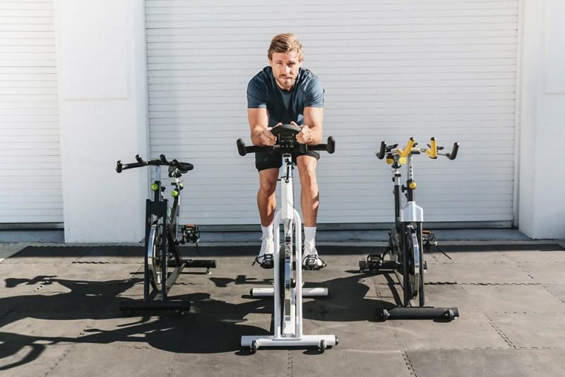 Model riding a Marcy training bike