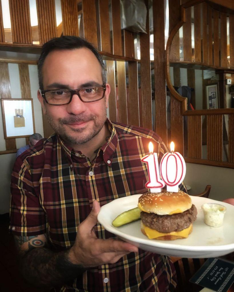 Food writer Nick Solares with hamburger