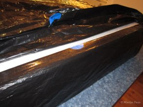 Put the whole painting pakage in a plastic bag and seal the openings, to prevent any potential damage from moisture.