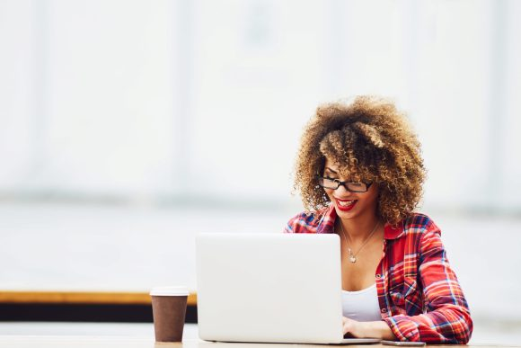 highly successful amazon sellers - young woman working on laptop