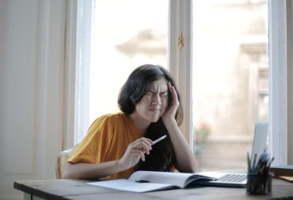 break from that screen - woman straining eyes