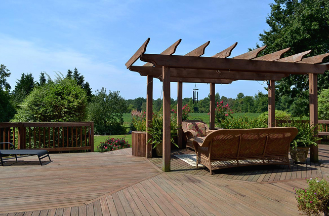 Pergola overlooks back area and beyond