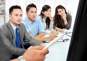 A group of employees watching a presentation.