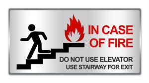 A fire warning sign on an office wall.