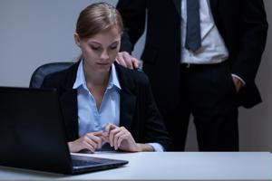 A female employee is harassed by a colleague.