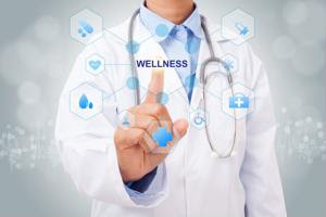"""A doctor touches a diagram labeled """"wellness."""""""