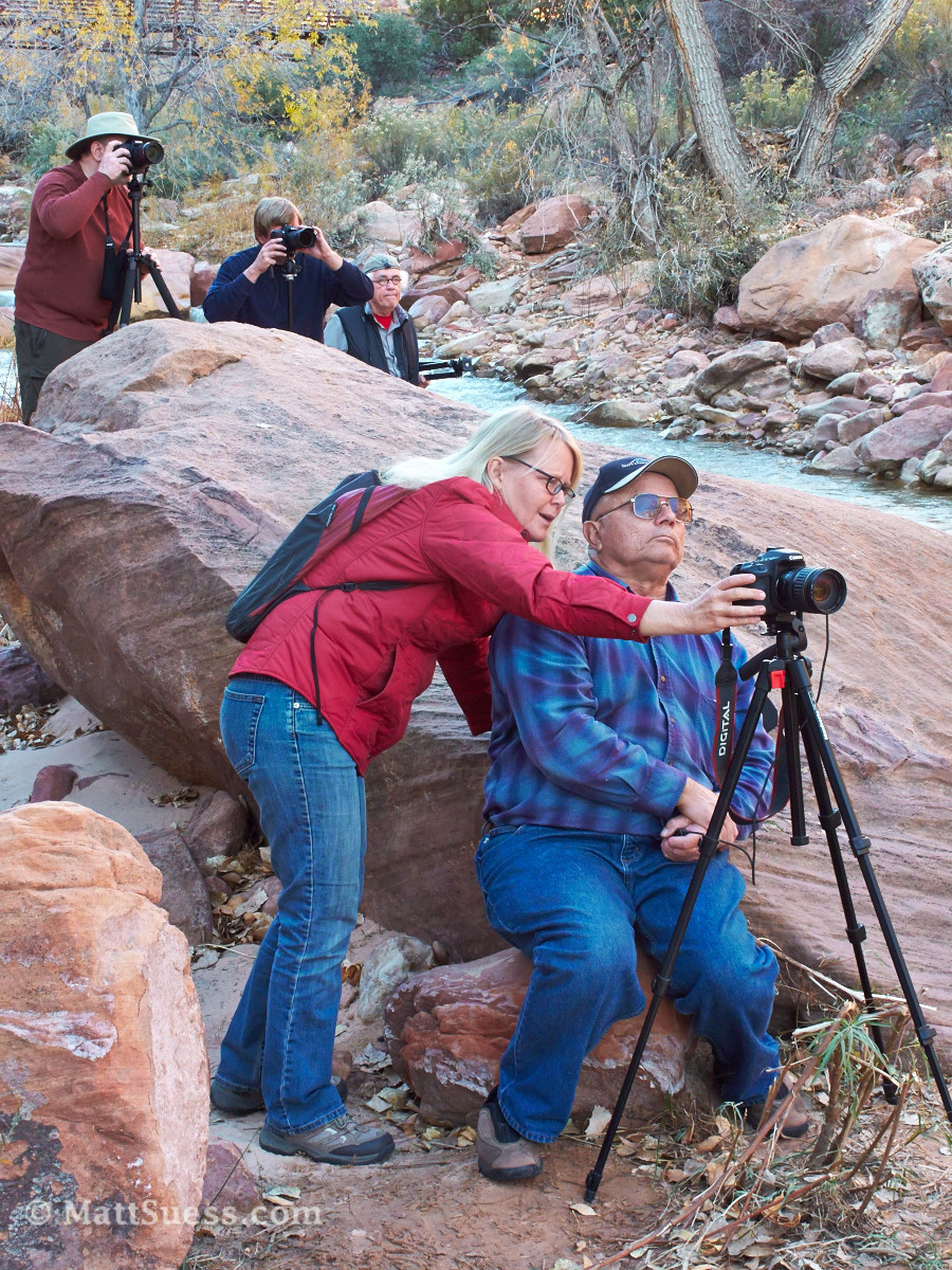 Christine helps a student as others look for an angle to photograph from.