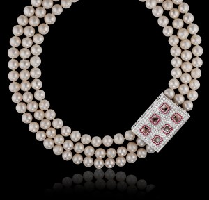 The Windows of Perception necklace can be worn either with massed strands of pearls or as a pendant.