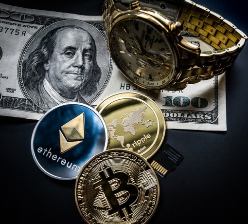 photo of Cryptocurrencies and dollar bill