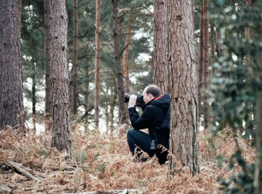 photographer in the woods