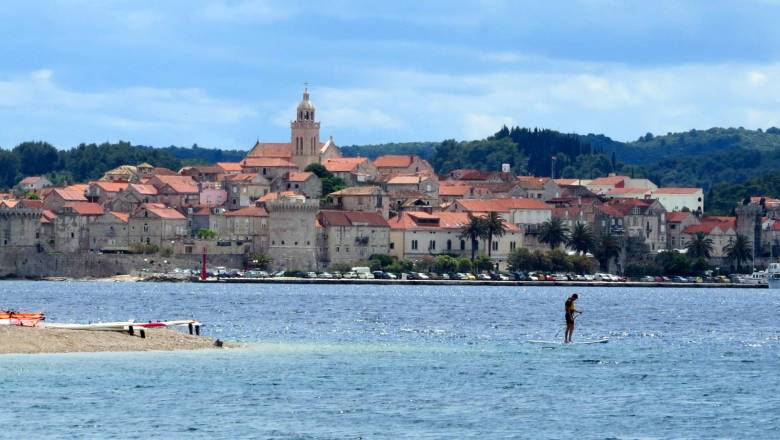 Stand up paddle on Peljesac, with great views on Korcula town in the background.