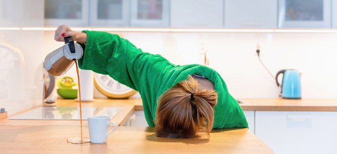 Sleep Deprived woman pouring coffee onto counter top