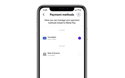 How do I select a default payment method in Metal Pay?