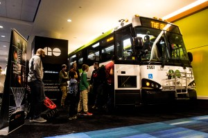 Families line up to see inside the GO bus at the AutoShow.