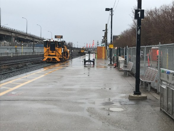Heavy machinery laying down new tracks at Exhibition GO during the rain.