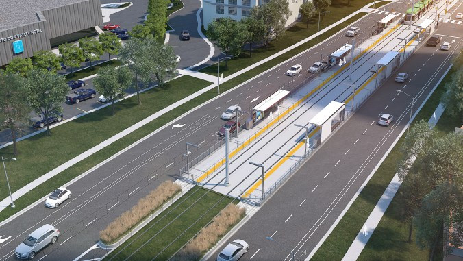 An artist concept shows a stop between active roads, with a light rail vehicle pulling up.