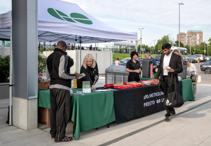 Customers are welcomed to Guildwood GO by community relations staff.