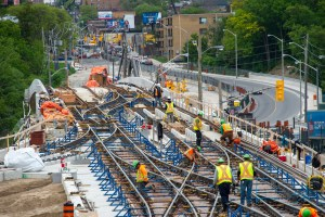 Crews work along tracks that twist and tun in a complicated pettern.