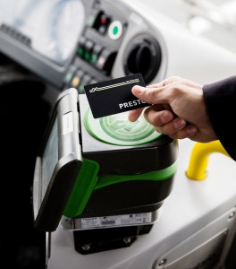 Photo of a person's hand tapping their PRESTO card on a PRESTO device.